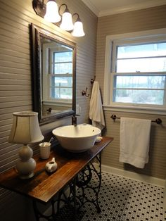 Love this bathroom & the sewing machine table sink.