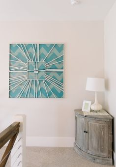 How cool is this giant clock?? The numbers are roman numerals, but it looks almost like a starburst clock. House of Turquoise: Four Chairs Furniture   Millhaven Homes