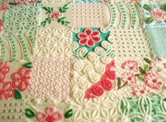 Baby quilt made from vintage chenille bedspread blocks.