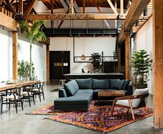 Brightly-colored geometric rugs are a perfect contrast to a stark industrial space, adding warmth and personality.
