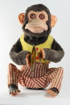 creepy monkey-my Grandpap had one of these i loved it my son cried everytime Pap would turn it on! that was 22 years ago.