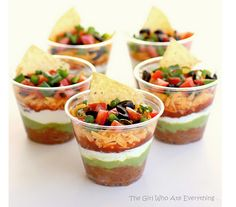 Individual cups of 7 layer Mexican dip. Yummmmmy! :)