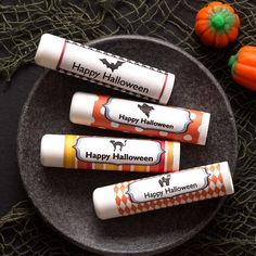"""Make your own Halloween lip balm labels with Avery 2"""" Square Labels and free templates at avery.com/halloween. Labels fit perfectly around most lip balms—no need to cut to size. #averyproducts #averylabels #avery22806 #avery #trickortreat #lipbalm #halloween"""