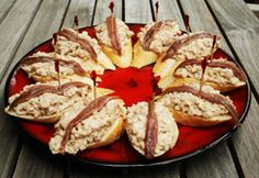 Basque Tapas made of Tuna with Chopped Onion garnished with Anchovy on Bread.