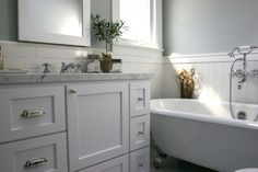 Fiorella Design: Spa-like bathroom with green gray walls paint color, glossy subway tiles backsplash, ...