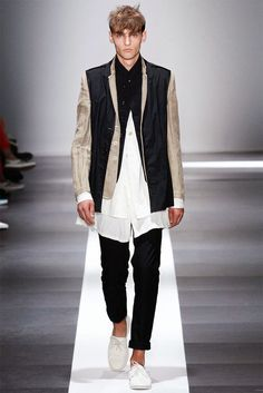 Ann Demeulemeester Spring/Summer 2015. Light and relaxed, long coats, tailored waistcoats and elongated tops came together with a monochromatic color scheme at large.