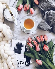 Flatlay Inspiration · via Custom Scene · Gorgeous chunky knit blanket and woolly jumper with a cup of tea! Add a touch of color with colorful tulips.