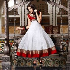 A vibrant white salwar suit with sleek red border from the Nakshatra collection for Diwali.