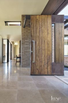 Contemporary Neutral Entry with Mud Brick Walls | LuxeSource | Luxe Magazine - The Luxury Home Redefined