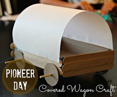 "A covered wagon from a cake box and popsicle sticks! See the detailed instructions at ""Blue Skies Ahead."""