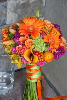Orange and Green Wedding - I'd like it more if the colors were more muted, but this is the right idea!