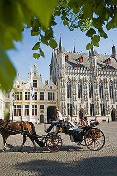 Belgium, Bruges, City Hall on the Burg, Town Hall Square, with Horse drawn Carriage