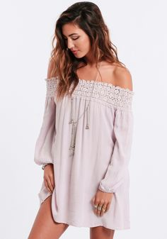 Pale lavender, off-shoulder dress with a shirred crochet top and three-quarter length sleeves with elastic cuffs.