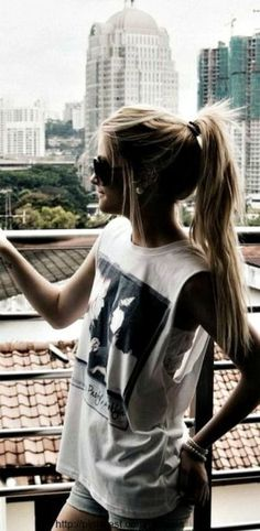 white graphic muscle tee, denim shorts, messy ponytail. tomboy, travel, casual, basic, comfy, simple, lazy day, kickback, lounge, weekend, hangout, summer outfit.