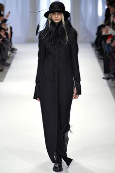 """FALL 2013 RTW  Ann Demeulemeester /   There have been times when Ann Demeulemeester's womenswear has been inspired by real-life poetesses, artists, adventuresses. The clear, forceful vision shaping today's show felt like one of those times. So, Ann, who was the real woman behind this collection?  """"I made everything I like,"""" she said. And that meant, in a word, Black and white, male and female, fluid and constructed, fragile and strong. All of it rolled together in one polymorphous package."""