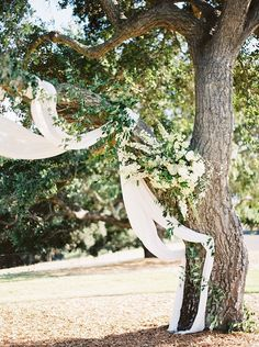 unique ethereal wedding ceremony decor ideas with fabric and flowers