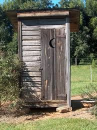 old outhouses..so glad times have changed when I see this!!