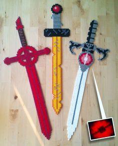 life sized swords - demonsword, gold sword, thundercat sword.