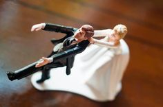 Bride pulling groom back funny cake topper | villasiena.cc