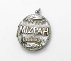 """You don't see many of these about. Its an antique silver Mizpah locket from the Victorian era. MIzpah jewellery is given between parted lovers, its from the saying """" May the Lord watch between thee and me when we are parted one from another"""". This silver locket measures about 3 cms long plus the hanging loops. It opens and shuts well and the hinge is fully working however there are signs of age related wear and this rare piece of antique jewellery has been priced accordingly"""