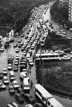 A traffic jam in northern Bucharest caused by heavy rains. Most people were still driving Dacias in the 90s—a Romanian Communist reproduction of an old Renault model.