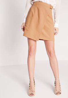 Buckle up and check out this fly buckle wrap mini skirt. This little beaut can be dressed up or down and its versatile colour means you can wear it with just about anything! Featuring square buckle detail, oversized pocket and in a wrap sty...