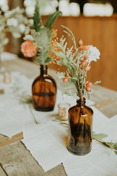 Thrifted brown glass bottles filled with coral + white blooms and greenery! How vintage and beautiful do these center pieces look against a white table setting. centerpieces diy Dreamy DIY Snohomish Wedding at Wildshoot Forest & Farm Bottle Centerpieces, Wedding Table Centerpieces, Diy Wedding Decorations, Wedding Ideas, Centerpiece Ideas, Centerpiece Flowers, Wedding Favors, Small Wedding Decor, Wedding Planning