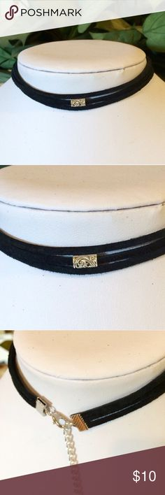 3 strand black leather choker This is made with black genuine leather suede. It has 3 strands. It is 13 to 14 inches long. The bead is a detailed antique silver. Lobster claw clasp. Handmade by me. This is my bottom price. Jewelry Necklaces