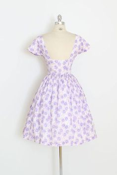 ➳ vintage 1950s dress * darling cotton sun dress! * purple rose print cotton * open back with button details * full skirt * metal side zipper condition | excellent fits like xs length 39 bodice 16 bust 34 waist 24-25 ➳ shop http://www.etsy.com/shop/millstreetvintage?ref=si_shop ➳ shop policies http://www.etsy.com/shop/millstreetvintage/policy twitter | MillStVintage facebook | millstreetvintage instagram | millstreetvintage 5984/172...