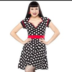 Sourpuss Polka dot Dollface dress size 2x Brand new dress from Sourpuss clothing size 2x. Never worn, new with tag. Stretchy cotton material with side zipper. Black with white polka dots and red waist panel and trim. Very flattering cut and full aline skirt. Sourpuss Dresses