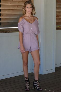 Delicate and soft mauve romper with cold shoulder sleeves and a gorgeous ruffle trim. Carrington point features a gathered waist, relaxed fit, tied straps in ba