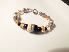 Hey, I found this really awesome Etsy listing at https://www.etsy.com/listing/241520534/tan-black-lampork-glass-focal-bead