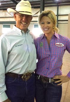Brittany Henson and Jim Rodgers, founder of the Cowboy Mounted Shooting Association. They are at the 2013 CMSA Classic Equine Eastern U.S. Championship.   Brittany is Wearing the Brand - our blue and pink windowpane Scottsdale shirt.