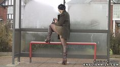 British milf in seamed fishnet pantyhose tights and boots flashing her pretty legs thighs at public bus stop.
