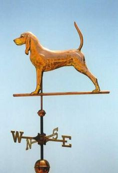 Black  Tan Coonhound Dog Weathervane by West Coast Weather Vanes.  Glass eye color can be selected to accommodate a  variety of dog eye colors.