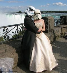 Actually, I think her dress is quite lovely, though her choice of veil makes me pause.