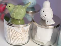This clever blogger found a way to clean and salvage nearly empty candles. What once held wax and wick now stores Q-tips and cotton balls — with a pretty bird on top.
