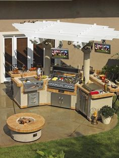 Outdoor kitchen - This Kitchen is my dream! TV's with football and all. Perfect!