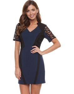 Short-sleeved dress with lace panelling. The Truese Travail Dress has a v-neckline, an invisible zip closure on the reverse, and sheer, lace, short sleeves. The dress features a structured, panelled design with lace side panelling and narrow, black panels on the front and the back. The Truese Travail Dress has a deep indigo fabrication, and offers a slim, stretch fit.
