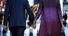 President Obama and first lady Michelle Obama hold hands as they walk back to the White House, Sept. after joining members of the White House staff during a moment of silence to mark the anniversary of Sept.