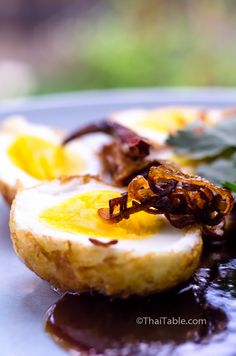 Son-in-law Eggs - fried boiled eggs served with sweet and sour tamarind sauce  http://www.thaitable.com/thai/recipe/son-in-law-eggs