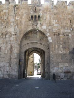 Lion Gate. Notice the two carved lions on each side of the gate. The protruding stone work above the gate is for pouring burning oil down on the enemy who is trying to break in the gate. Arrow slots are visable like narrow windows.