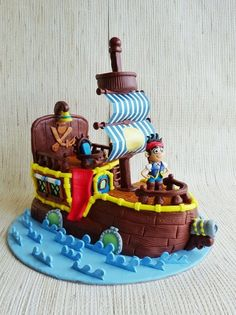Jake and the Neverland Pirates Bucky the Boat Cake by HaveSomeSugar.... of course this would be the cake landon would choose... the most detailed one!