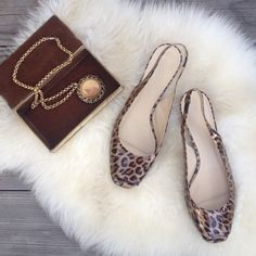 Leopard Print Patent Kitten Heel Classic Leopard kitten heel by hi end Designer brand Faconnable. Retro styling and low heel has great vintage style. Slight peep toe.       Worn once - like new!  Patent genuine leather. Faconnable Shoes Heels