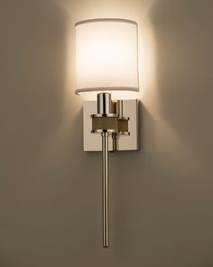 Boyd Lighting's Topanga I ADA Sconce was designed by Jamie Drake. This customize-able, architectural masterpiece is available in six metal finish options, five shagreen color options, three wood finish options and two shade options. Style: transitional, contemporary