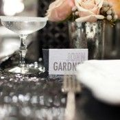 black glitter on place cards, silver vases