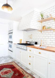 { kitchen :: subway tile, white cabinets, gold hardware + butcher block countertop }