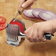 Fruit  Vegetable Holder gives you perfect slices and protects fingers from knicks and cuts---NEED.