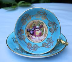 Antique Aynsley Tea Cup and Saucer. Turquoise Bone China Tea Set. Fruit Inside of Cup is Hand Painted by D. Jones. di AnythingDiscovered su Etsy https://www.etsy.com/it/listing/165348690/antique-aynsley-tea-cup-and-saucer