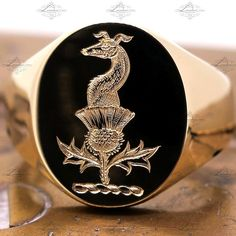 Surface engraved greyhound & thistle crest on a yellow gold signet ring. By LONDON ENGRAVER